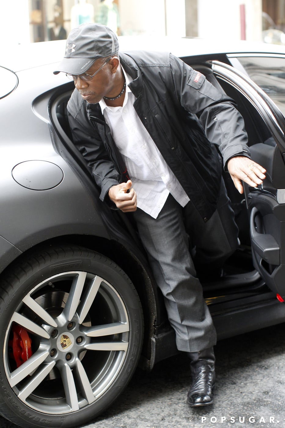 Kanye's father, Ray West, arrived at Lanvin with his son on Thursday.