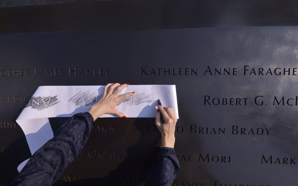 Katherine Fisher made a rubbing of her uncle's name, Andrew Fisher, at the 9/11 Memorial in NYC.