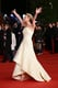 Jennifer Lawrence threw up her hands with a smile at the premiere of The Hunger Games: Catching Fire.