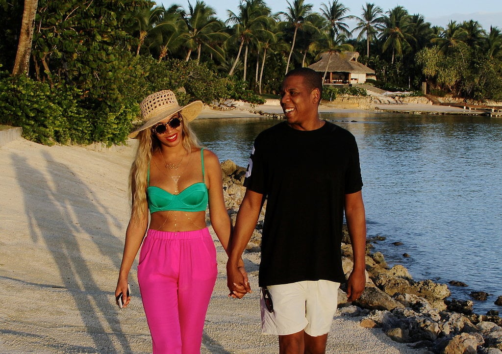 Beyoncé and her husband, Jay Z, walked hand in hand on vacation, with Bey turning heads in her bright bikini top and high-waisted pants. Source: Tumblr user Beyoncé Knowles