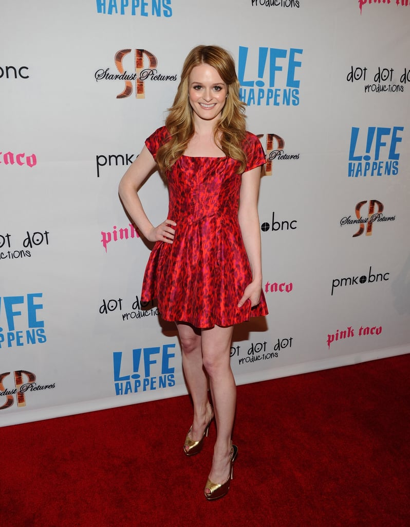 Fallon Goodson in a bright red dress at the premiere of Life Happens.