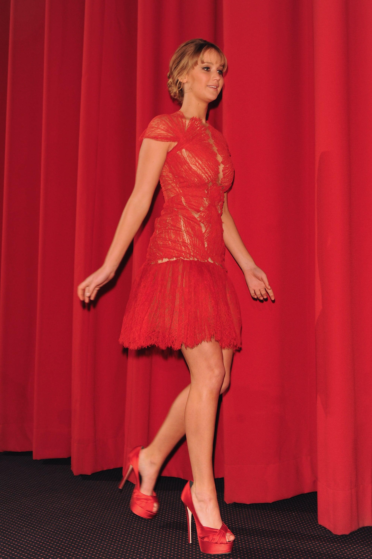 Jennifer Lawrence hit the premiere in a fiery red Marchesa.