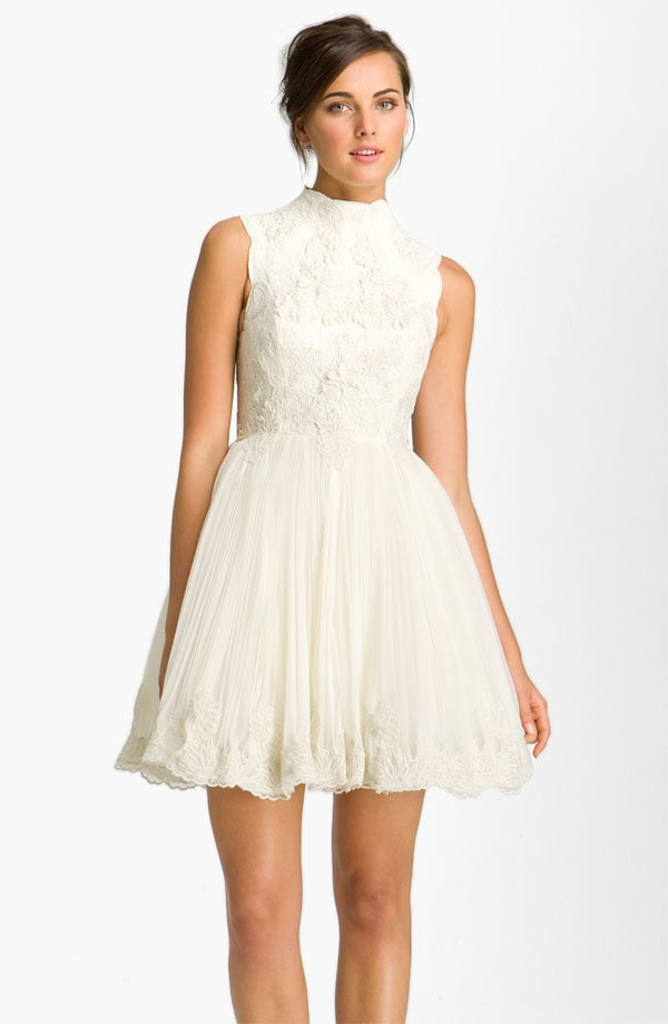 We think this sweet skater-style dress is ideal for a night of dancing at a fun family wedding — it feels just a bit more dressed down than something with a longer hemline and has a youthful edge.  Ted Baker London Telago Embroidered Tulle Frock ($825)