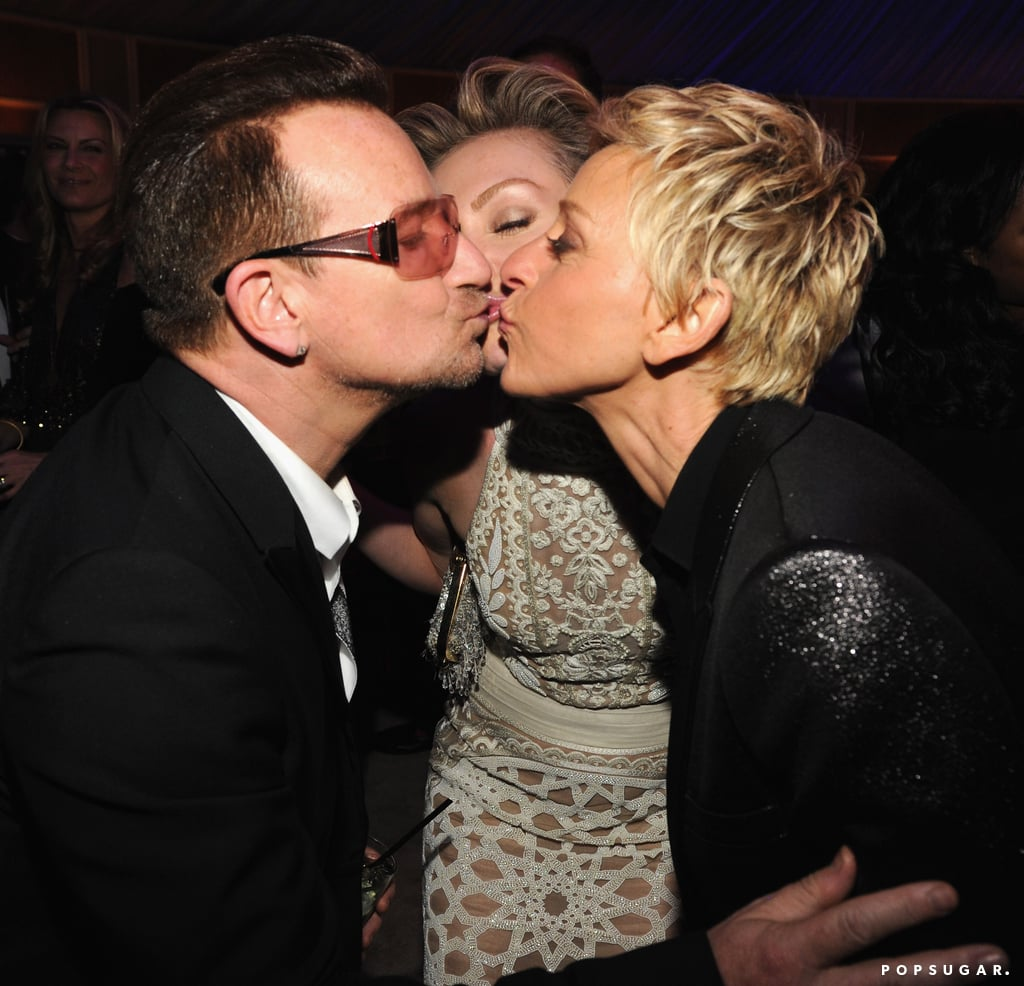 Bono, Portia de Rossi and Ellen DeGeneres locked lips inside the party.