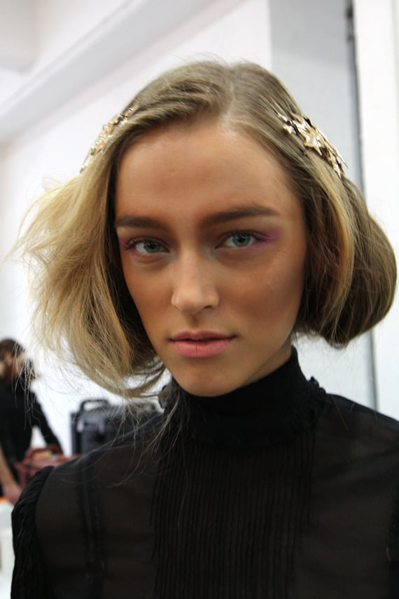 """The finished look. James Kaliardos for NARS wanted models to look bronzed. """"But not in a beachy, Miami or LA  way,"""" he explained. """"The inspiration is Australia."""" To create the sun-dappled, dusty look, he contoured models' cheeks with Laguna bronzing powder and Madly blush, adding Gaiety blush around the eyes for a boost of pink."""