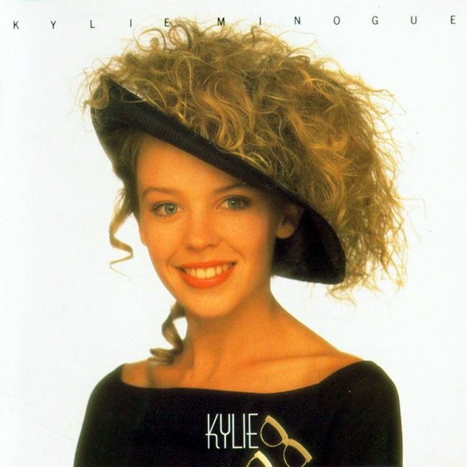 Kylie by Kylie Minogue My first album was on vinyl. It was Kylie Minogue's debut album (imaginatively called Kylie), and I remember being mesmerized by the picture on the cover, where she was wearing a saucer-shaped hat with all her hair spilling out of the top. If I remember, it came out of the discount section quite a while after the original release, which would make sense given that I was apparently 5 years old when the album was released and probably wouldn't have even been able to work the stereo to be able to play it! — Gemma Cartwright, POPSUGAR UK editor