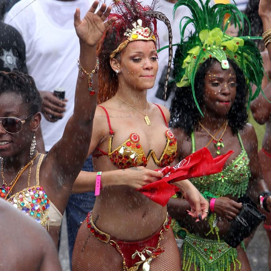 Pictures of Rihanna in Barbados Wearing a Bikini and Feathers