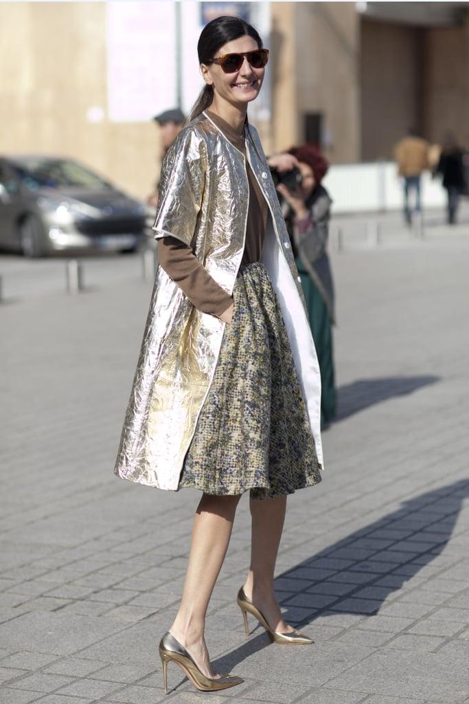 Giovanna Battaglia made an entrance in metallic coat and full skirt.
