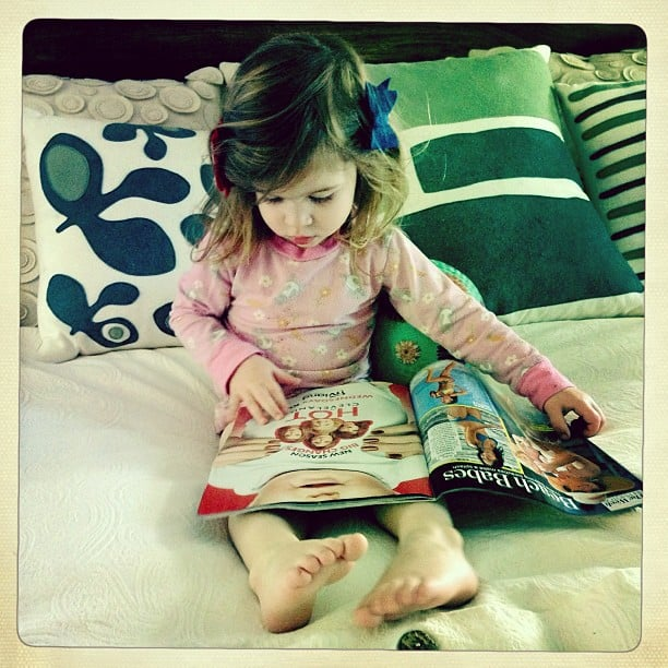Harper Smith caught up on her celeb gossip while resting on her mama's bed. Source: Instagram user tathiessen