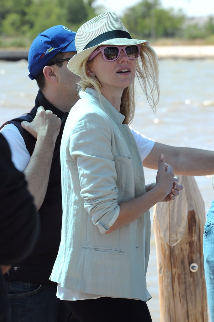 Naomi Watts waited for a boat on a dock.