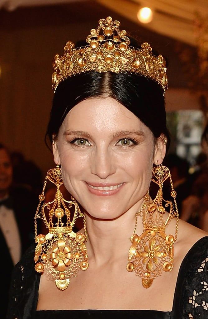 Tabitha Simmons wore an ornate gold crown and oversize earrings.