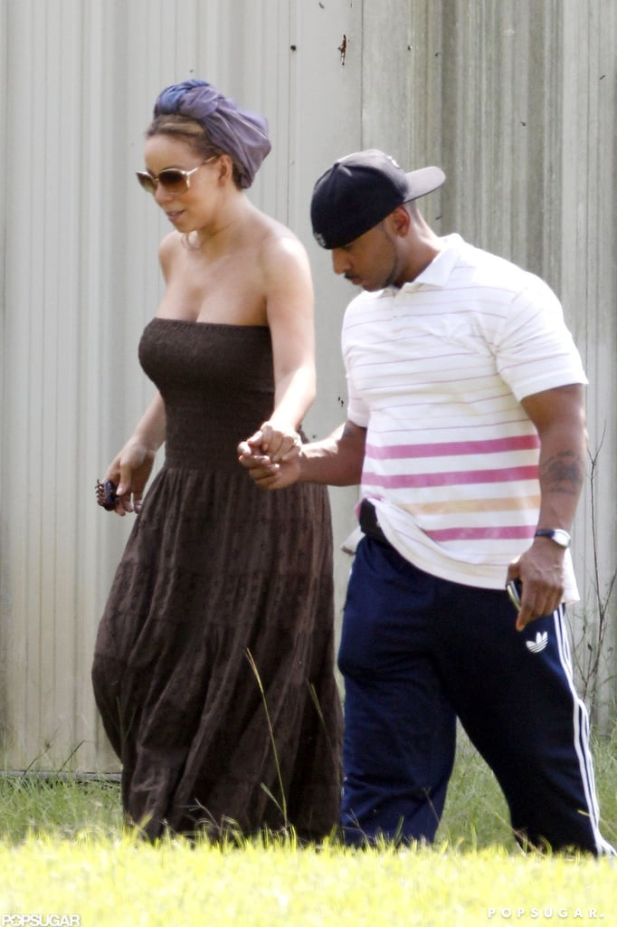 Mariah Carey wore a purple headscarf in New Orleans.