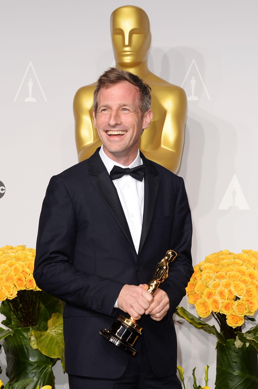 Spike Jonze smiled after winning best original screenplay for Her.