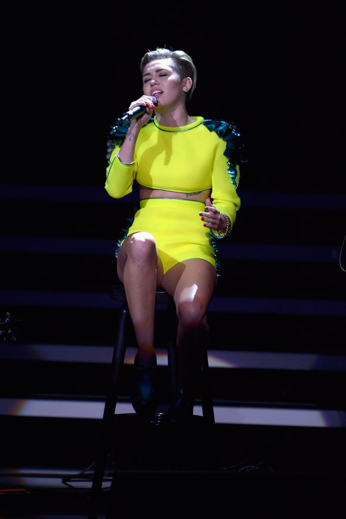 Always one to stand out, Miley worked a neon yellow embellished crop top and matching high-waisted shorts, both from The Blonds Spring 2014 collection, for her 2013 Bambi Awards performance.