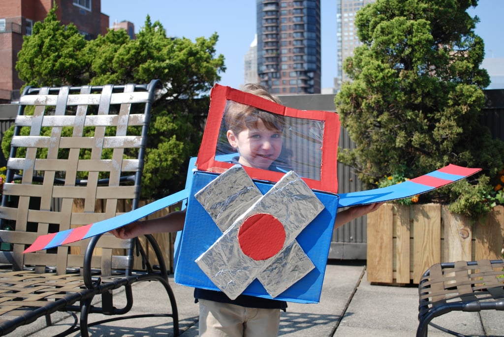 Have you child place his arms through the arm-holes to move the plane wings as he flies down the street.