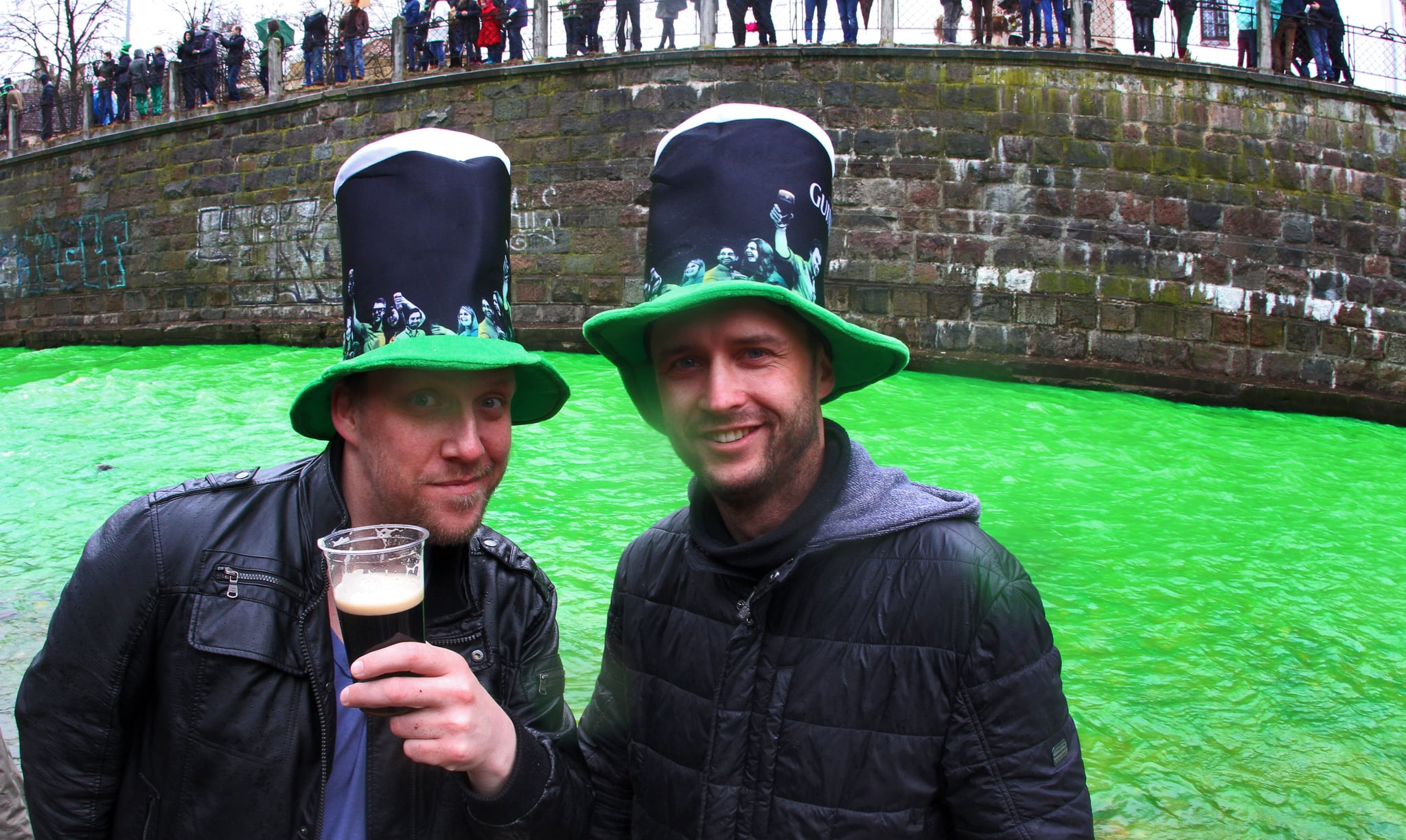 Lithuanians toasted beside a green river.