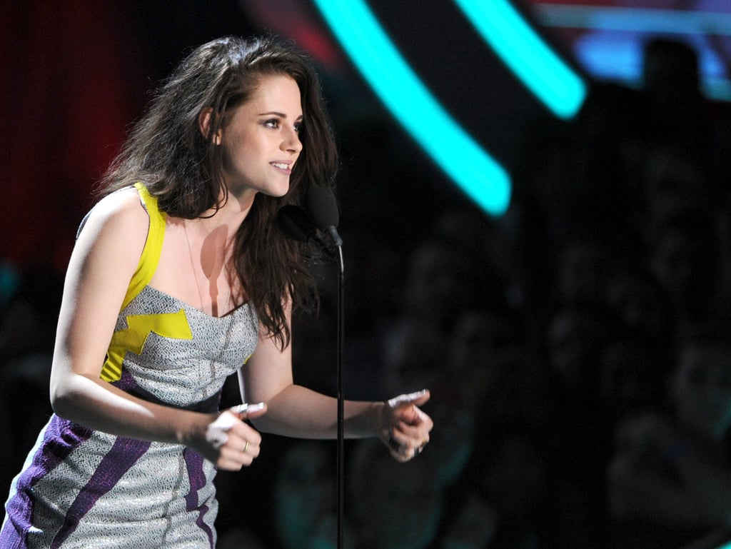 Kristen Stewart presented the best female performance award to Jennifer Lawrence, who was out of the country filming a new project.