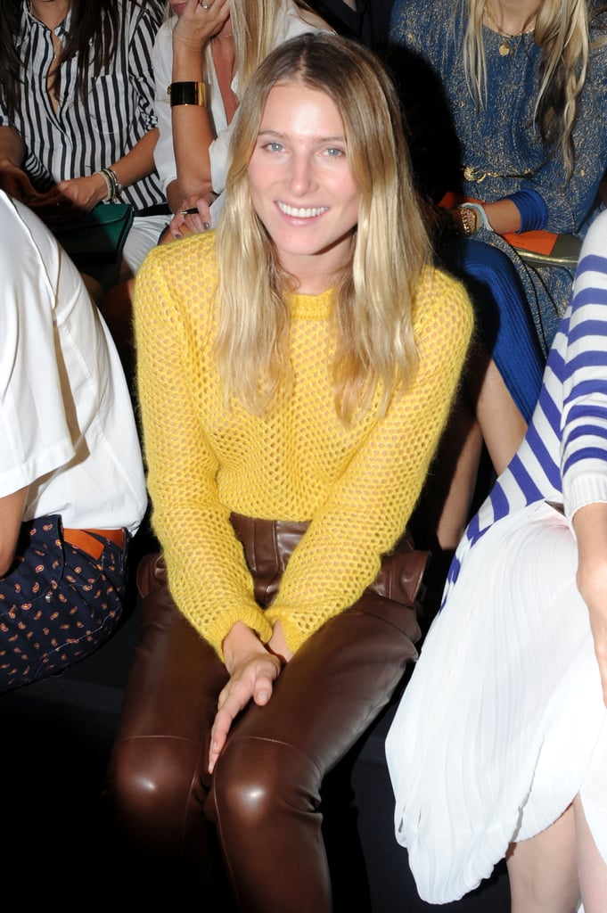 Dree Hemingway styled up a gorgeous look, in a yellow knit and contrasting leather pants, front row at Ermanno Scervino.