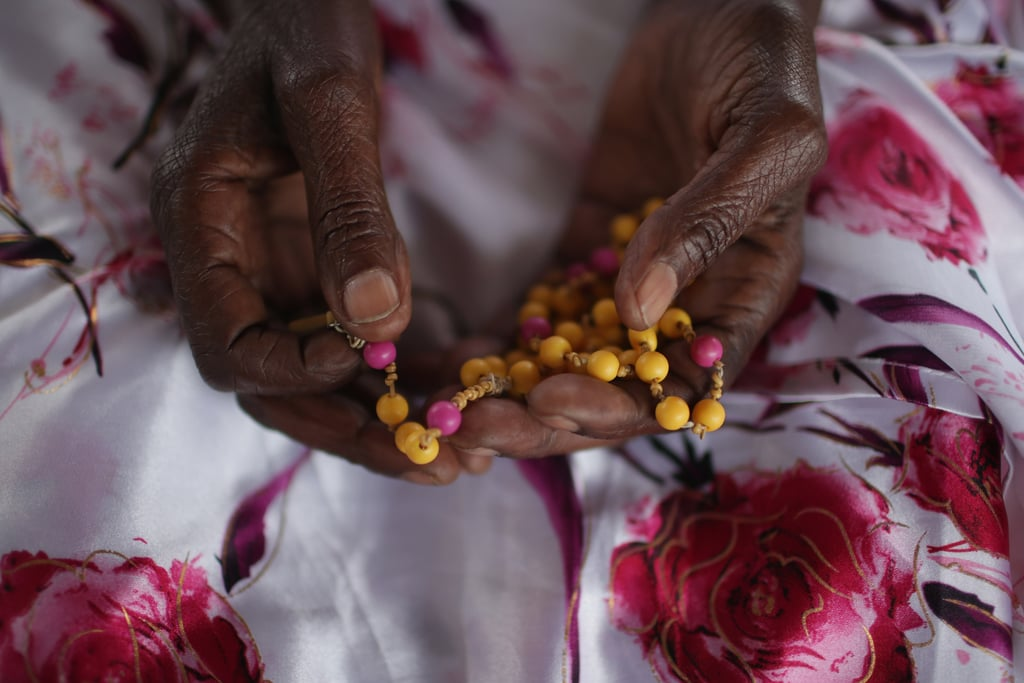 Ophelia Nyiramgumeri held a rosary that belonged to her nephew, who was murdered in the genocide, in her Kigali home on Saturday.