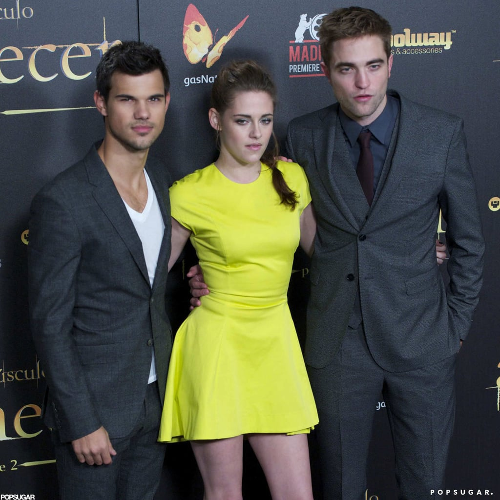Kristen Stewart posed for photos with Robert Pattinson and Taylor Lautner.