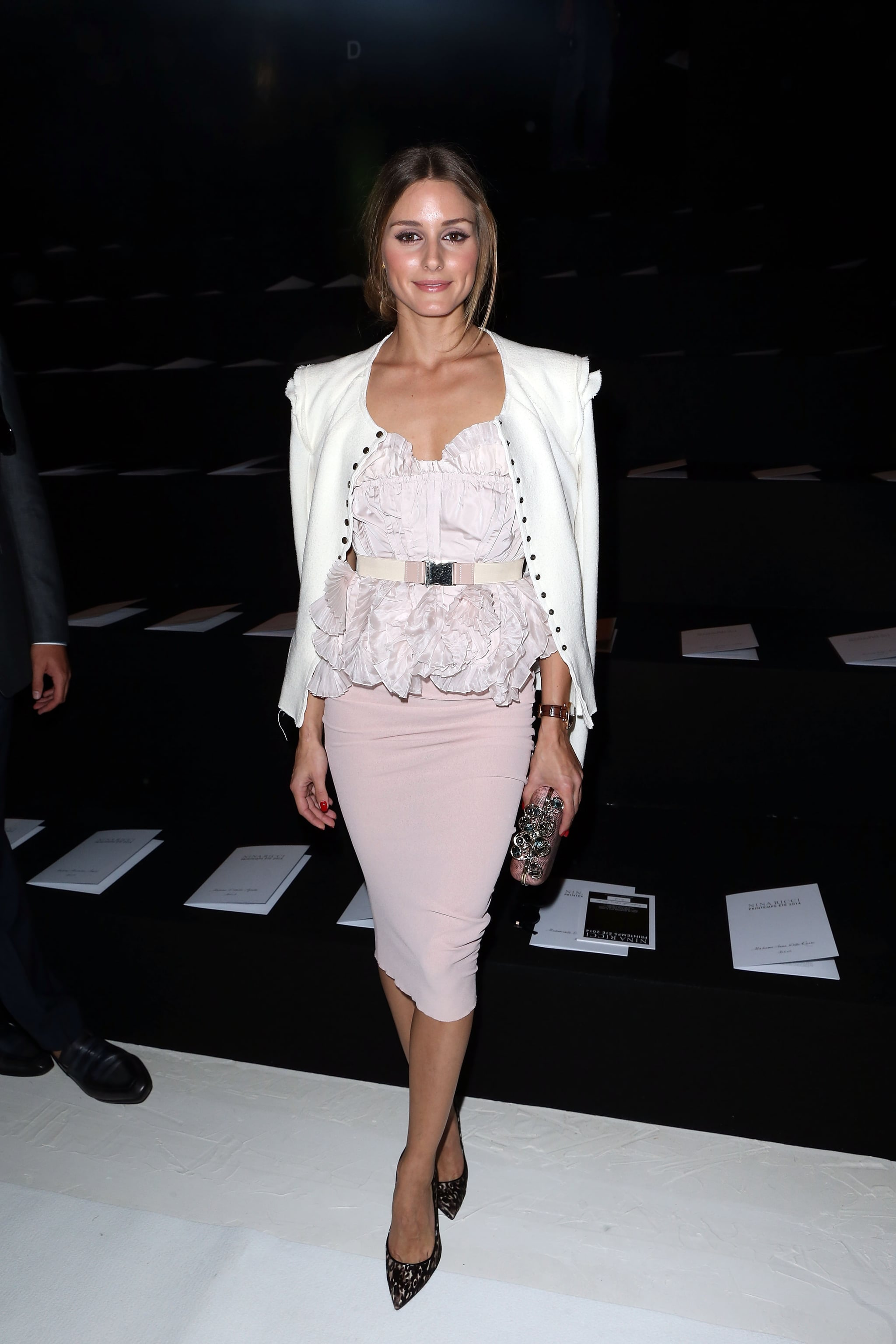 Olivia went ladylike in ruffled and soft pink for the Nina Ricci Spring show.