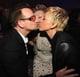 Ellen DeGeneres and Portia de Rossi went in for a three-way kiss with Bono at the Vanity Fair bash.