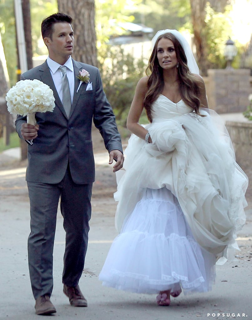 Matt Lanter and Angela Stacy walked together on their wedding day.