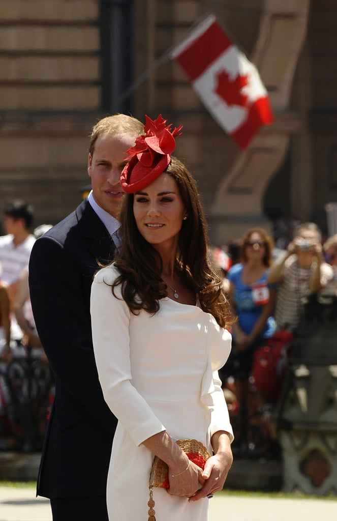 Prince William and Kate Middleton posed near a Canadian flag.