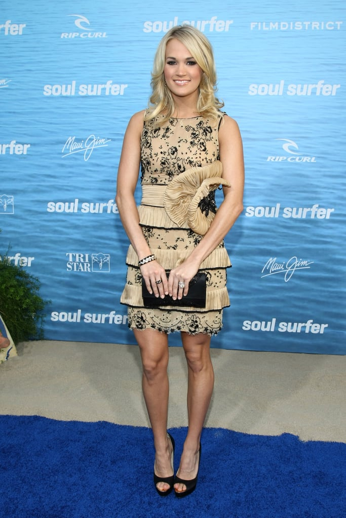 For the 2011 Hollywood premiere of Soul Surfer, Carrie chose a nude silk Zuhair Murad cocktail dress, complete with hand-embroidered black lace, a tiered skirt, and flower-adorned waist.