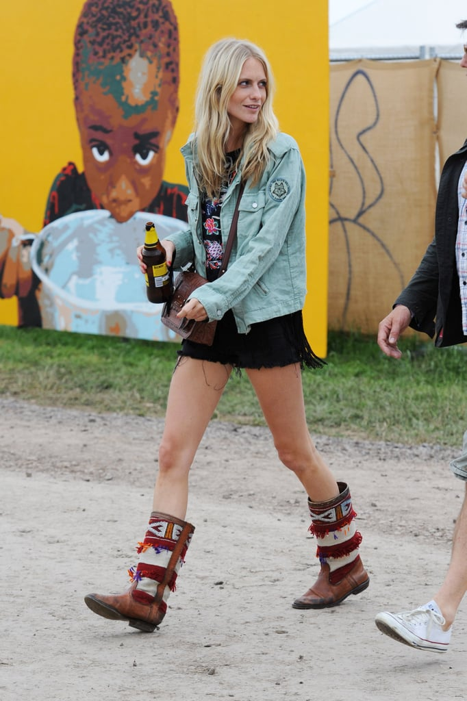 Poppy's festival style was in full force at Glastonbury with beaded and embroidered boots and a laid-back jacket-and-dress combo.
