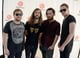 The guys of Imagine Dragons posed for pictures backstage at the festival.