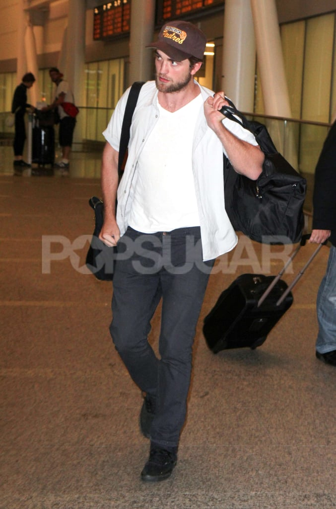 Robert Pattinson carried two bags at once in Toronto.