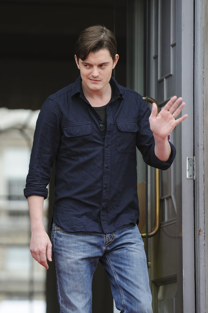 Sam Riley waved to fans.