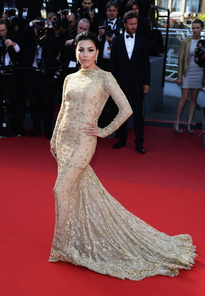 Eva Longoria in a long-sleeved gold lace and embellished Zuhair Murad gown at the Le Passé premiere in Cannes.