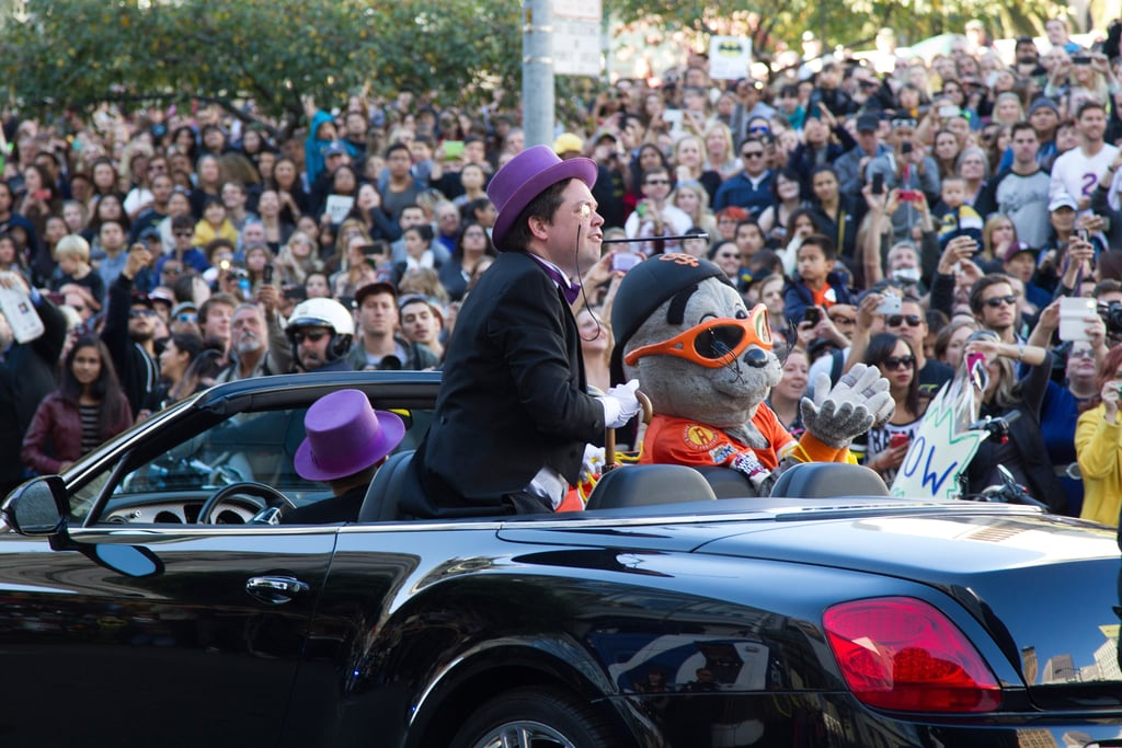 Supporters snapped pictures as the Penguin kidnapped Lou Seal, the Giants mascot, at Union Square.