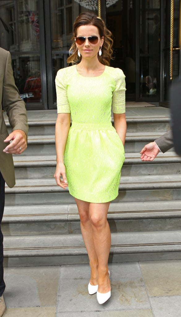 She wore a brighter than bright lime green Preen sheath with white pumps on one of her many London appearances.