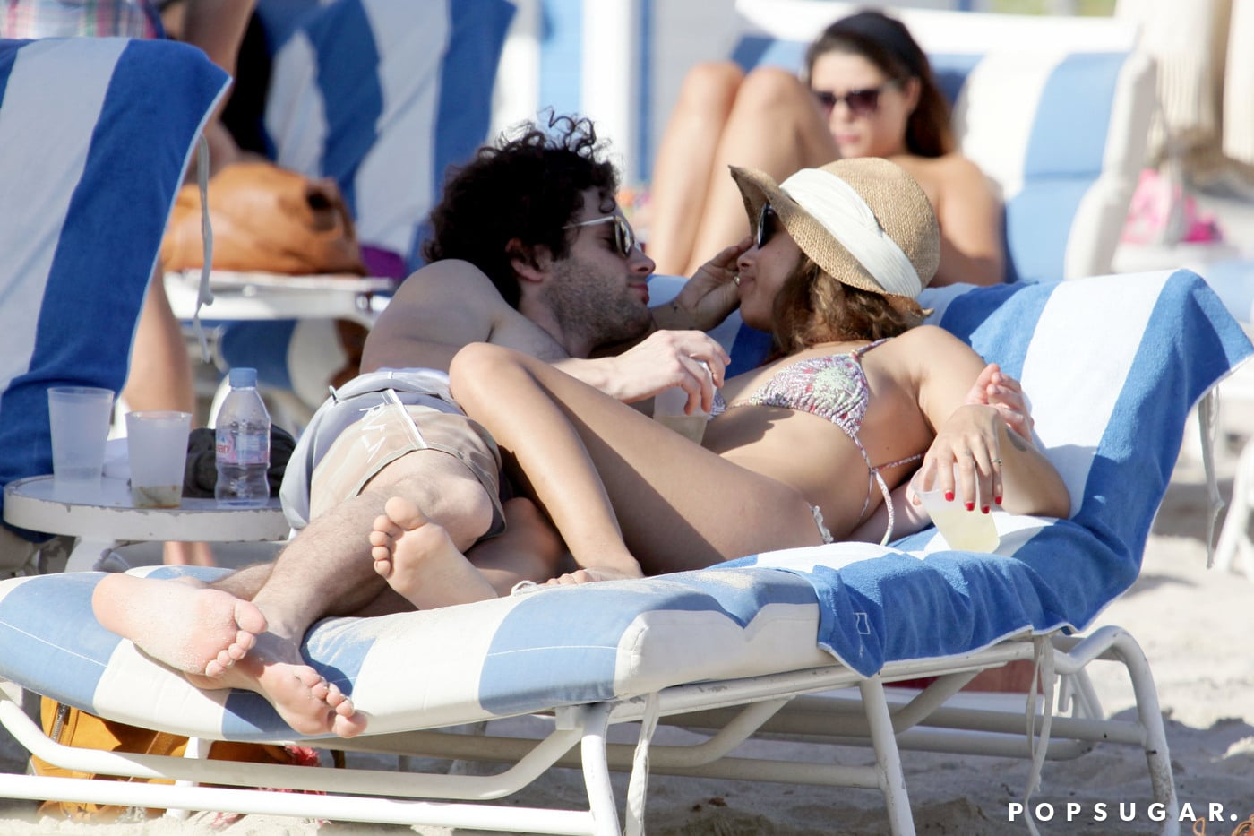 Bikini-clad Zoe Kravitz cuddled with shirtless Penn Badgley in Miami during a vacation in December 2011.