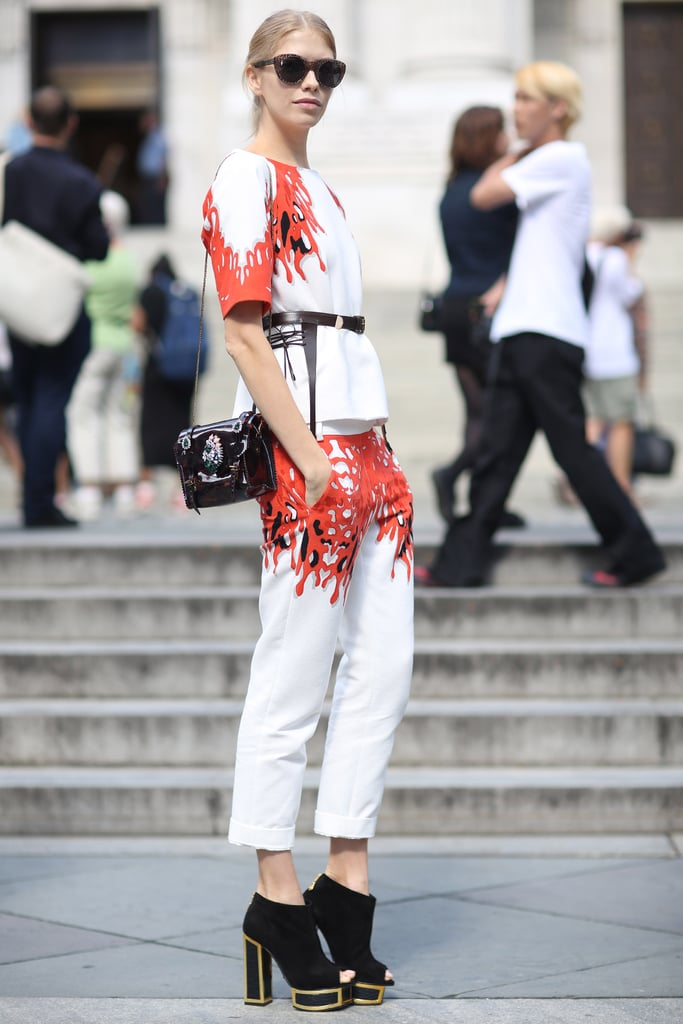 Bold print acts like a frame on this white top and trouser set — the whole look also gets a lift via platform open-toe booties. Source: Greg Kessler