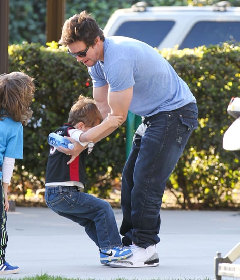 February-Mark-Wahlberg-let-his-son-stand-his-feet-while