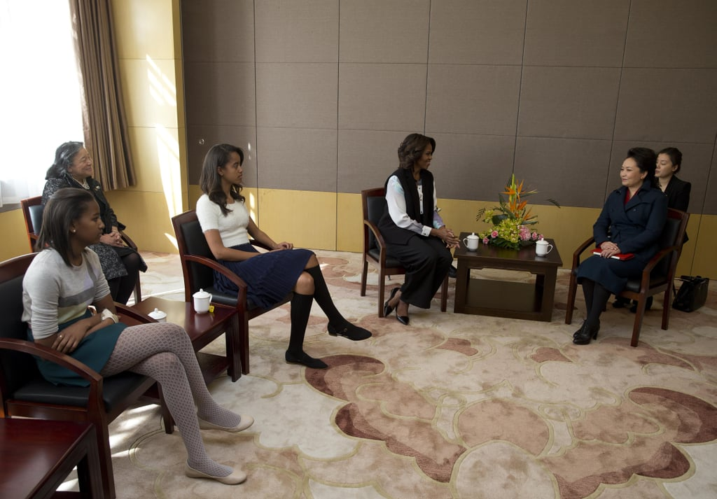 First Lady Michelle Obama was joined by her daughters for a school visit in Beijing.