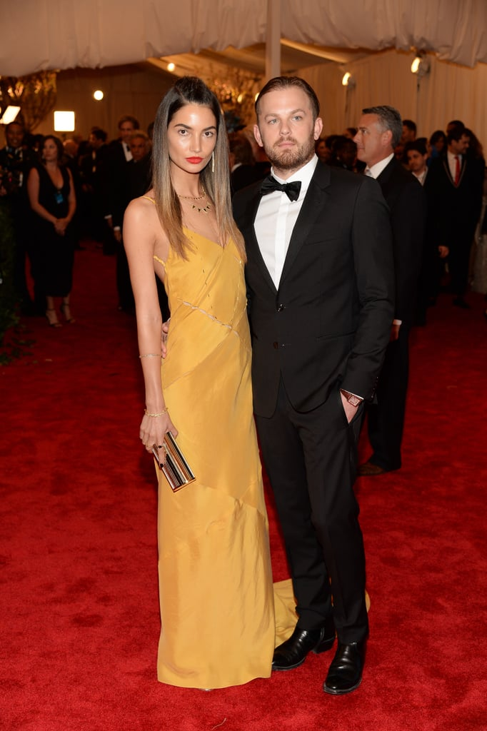 Lily Aldridge was sunny in a yellow Tommy Hilfiger gown with a Jimmy Choo clutch.