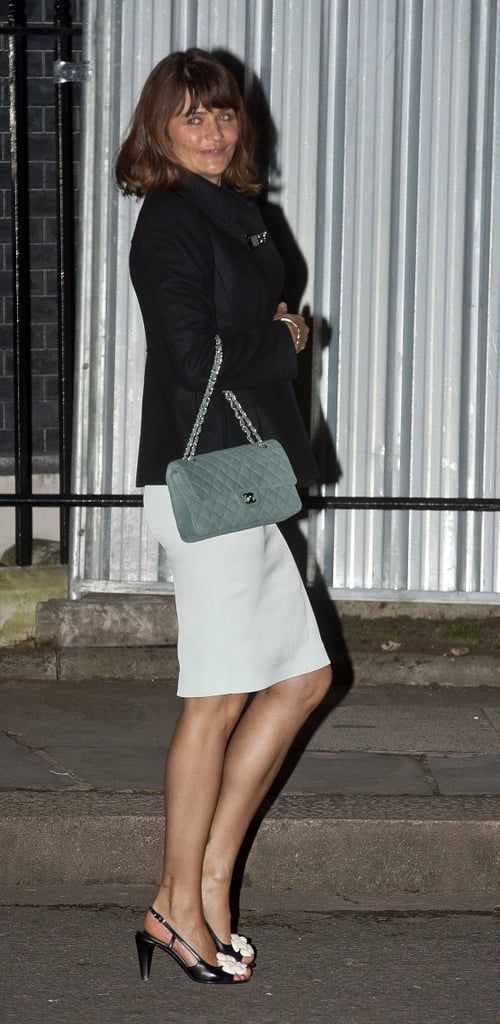 Helena Christensen's green Chanel bag stole the spotlight against her black coat and pastel-blue pencil skirt at a London Fashion Week soiree.