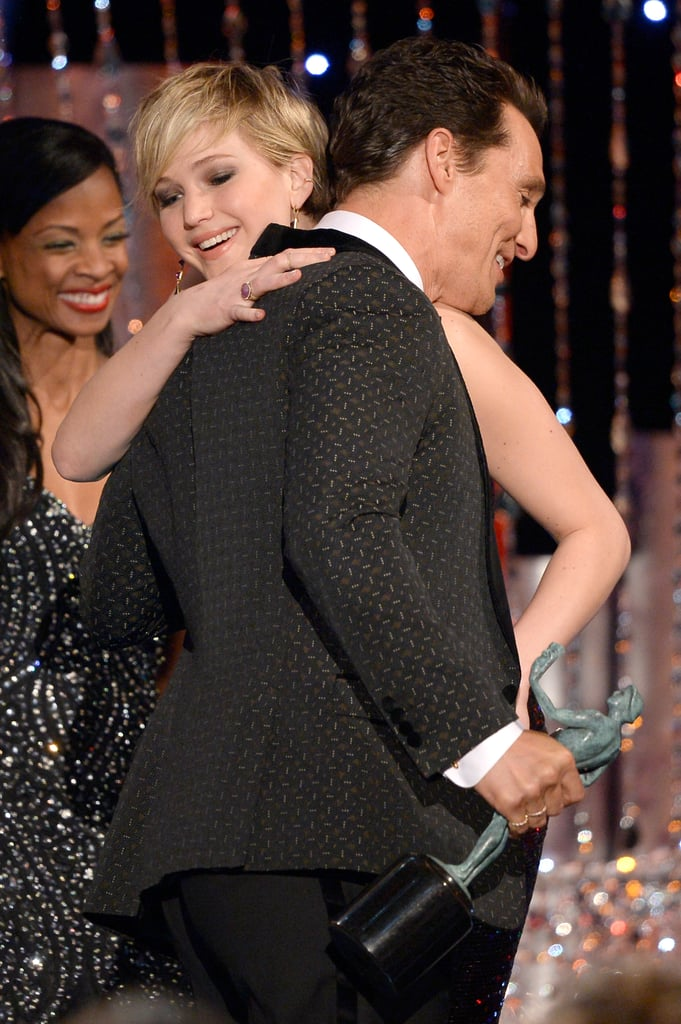 Matthew hugged Jennifer Lawrence after she presented him with his award.