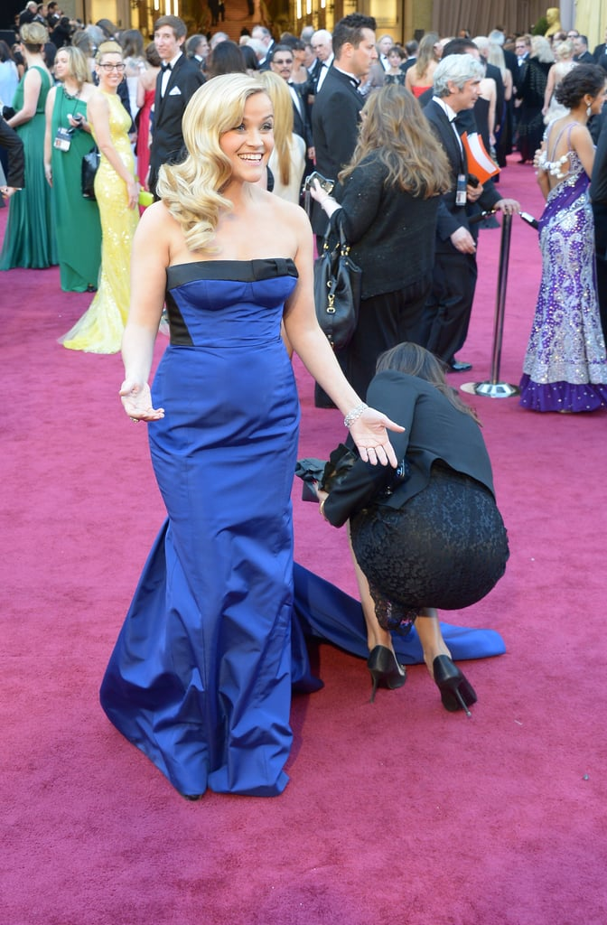 Reese Witherspoon waited for the perfect moment to pose in her Louis Vuitton gown.