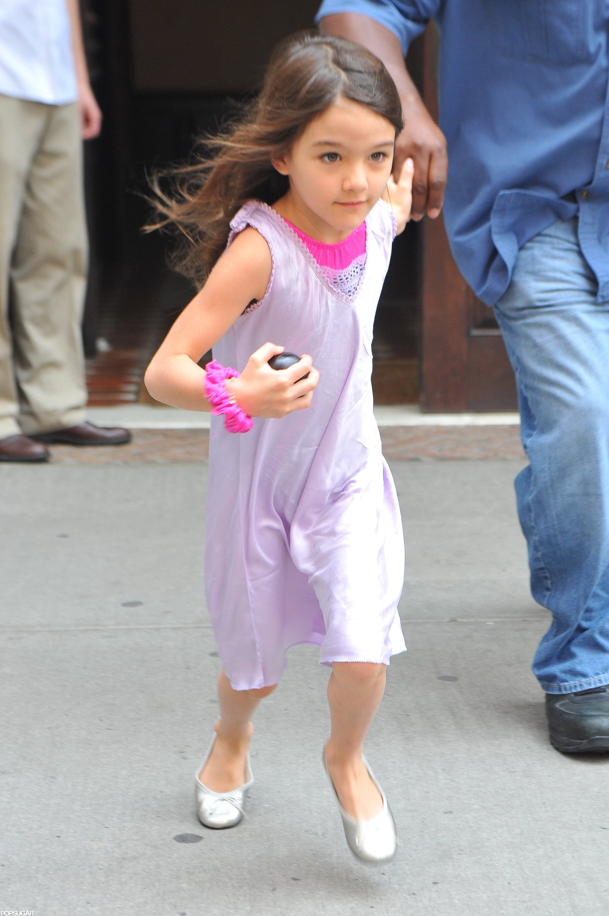 Suri Cruise made a run for the car in NYC.