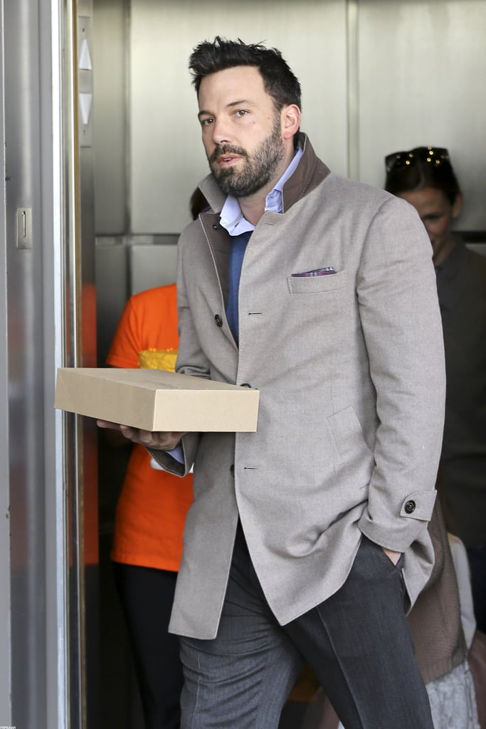 Ben Affleck carried a box of sweets into Seraphina Affleck's birthday party.