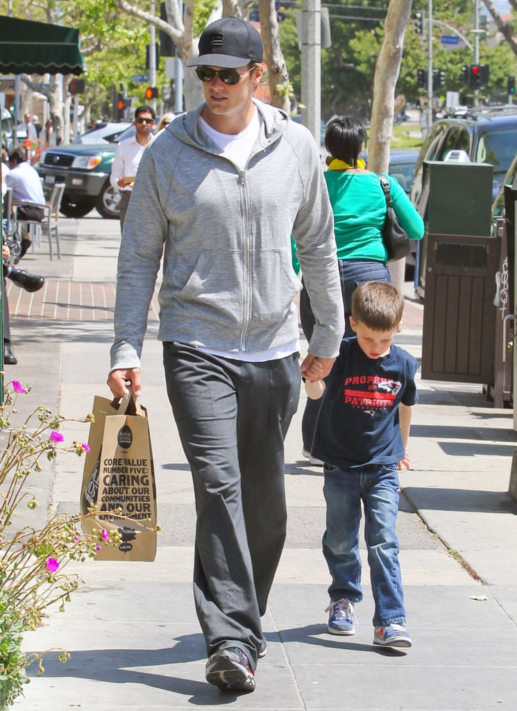 Tom Brady led Jack Moynahan down the street as they left Whole Foods Market.