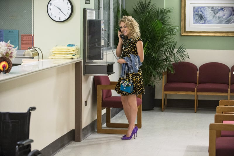A full shot of Carrie's colorful look. Check out her regal purple Kate Spade pumps ($198, originally $328).