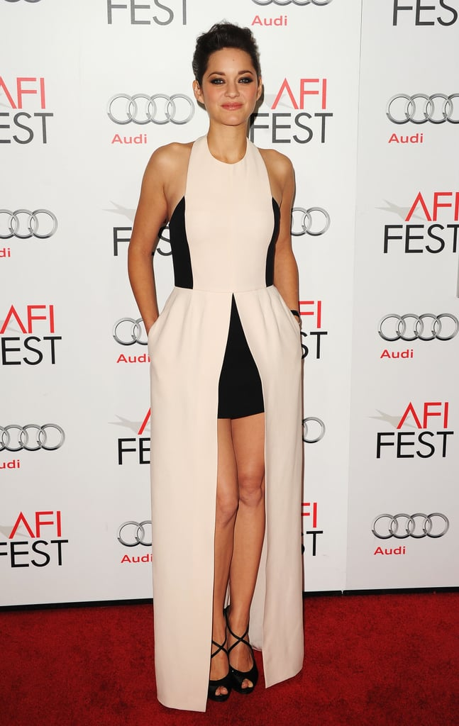 Marion Cotillard attended the AFI fest in a beige and black gown by Christian Dior paired with black Dior sandals and Chopard jewels.