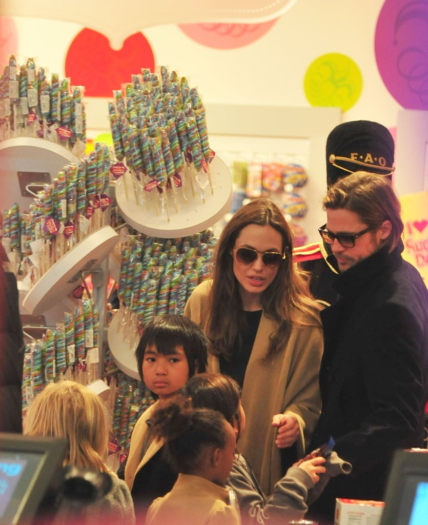Brad Pitt and Angelina Jolie helped the kids pick out holiday toys.